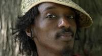 Son vrai nom est Keinan Abdi Warsame. Il est né le 1er février 1978 à Mogadiscio, Somalie. Son nom de scèneK'naan signifie « voyageur » en Somalien.« En Somalie, […]