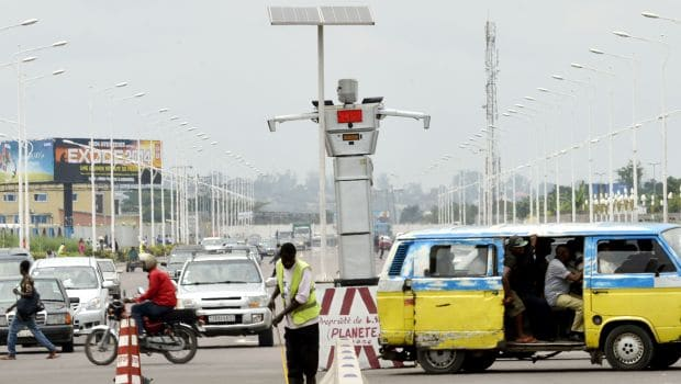 TO GO WITH STORY BY KATHY KATAYI AND JUNIOR KANNAHThis picture taken on January 22, 2014 shows a traffic robot cop on Triomphal boulevard of Kinshasa at the crossing of Asosa, Huileries and Patrice Lubumba streets. Two human-like robots were recently installed here to help tackle the hectic traffic usually experienced in the area. The prototypes are equipped with four cameras that allow them to record traffic flow, the information is then transmitted to a center where traffic infractions can be analyzed. The team behind the new robots are a group of Congolese engineers based at the Kinshasa Higher Institute of Applied Technique, known by its French acronym, ISTA. AFP PHOTO / JUNIOR D. KANNAH