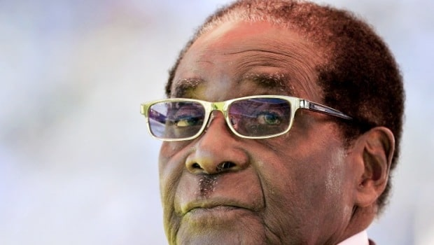 Zimbabwean President Robert Mugabe looks on during his inauguration and swearing-in ceremony on August 22, 2013 at the 60,000-seater sports stadium in Harare. Veteran Zimbabwean President Robert Mugabe was sworn in as Zimbabwe's president for another five-year term before a stadium packed with tens of thousands of jubilant supporters. AFP PHOTO / ALEXANDER JOE