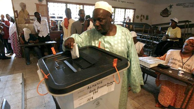 A Guinean man casts his vote at the Al Moustapha school in Conakry