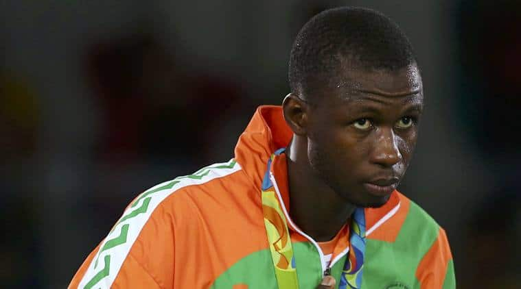 2016 Rio Olympics - Taekwondo -Men's +80kg Victory Ceremony - Carioca Arena 3 - Rio de Janeiro, Brazil - 20/08/2016. Issoufou Alfaga Abdoulrazak (NIG) of Nigeria celebrates on the podium     REUTERS/Peter Cziborra (BRAZIL  - Tags: SPORT OLYMPICS SPORT TAEKWONDO) FOR EDITORIAL USE ONLY. NOT FOR SALE FOR MARKETING OR ADVERTISING CAMPAIGNS.