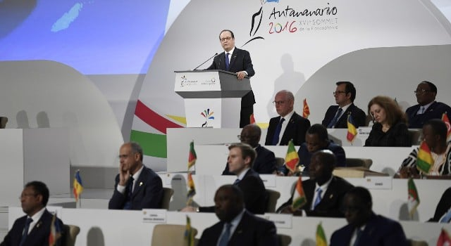 French president Francois Hollande speaks during the opening of the 16th Francophonie Summit in Antananarivo on November 26, 2016. The International Organisation of La Francophonie represents one of the biggest linguistic zones in the world. The International Organisation of La Francophonie was created in 1970. / AFP PHOTO / STEPHANE DE SAKUTIN