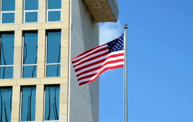 View of the US flag raised over the US Embassy building in Havana on August 14, 2015, during US Secretary of State John Kerry's (out of frame) visit. The Marine guard of the newly reopened US embassy in Cuba raised the flag over the building Friday for the first time in 54 years, marking the end of the countries' Cold War standoff. AFP PHOTO/STR