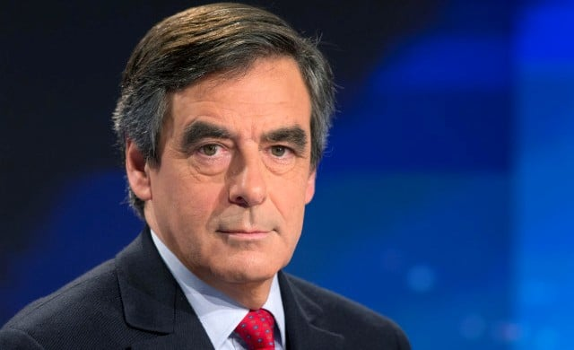 "France's former prime minister and member of the right-wing UMP party Francois Fillon poses on November 9, 2014 prior to speaking during the evening news on French private channel TF1 at their Boulogne-Billancourt studios, outside Paris. France's former prime minister Francois Fillon complained on November 9 of a ""plot"" against him, amid media revelations he sought to interfere in legal procedures against Nicolas Sarkozy, a rival in the right-wing opposition. AFP PHOTO / KENZO TRIBOUILLARD"