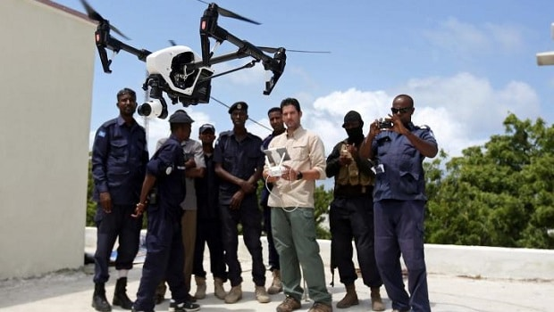 Somali police officers watch instructor Brett Velicovich fly a DJI Inspire drone during a drone training session for Somali police in Mogadishu, Somalia May 25, 2017. REUTERS/Feisal Omar