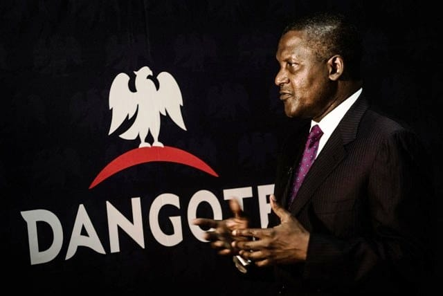 Aliko Dangote, chief executive officer of Dangote Group, gestures after signing a factory construction contract with Sinoma International Engineering Co. Ltd. in Lagos, Nigeria, on Wednesday, Aug. 26, 2015. Dangote Cement has expanded capacity five-fold in the last four years as the company invested outside its home market. Photographer: Tom Saater/Bloomberg