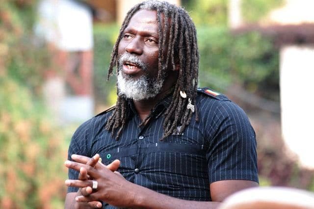 (FILES)-- A file photo taken on February 14, 2015 shows Ivorian reggae artist Moussa Doumbia, known as Tiken Jah Fakoly, speaking during an interview in Goma. Fakoly was turned back upon his arrival at the airport of Kinshasa on June 19, 2015, where he was supposed to give a concert on June 21 at the Jazz Kif 2015 festival. According to an organizer of cultural events in Kinshasa and a diplomatic source, it has become extremely difficult to bring artists into the country since March 15, when about thirty people, including rappers and civil society activists, were arrested during a meeting on good governance in Africa. AFP PHOTO / FLORY MUMENA