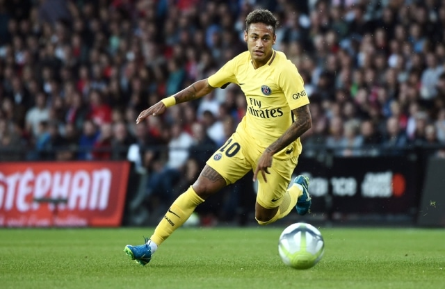 Paris Saint-Germain's Brazilian forward Neymar drives the ball during the French L1 football match Paris Saint Germain vs En Avant Guingamp at the Roudourou stadium in Guingamp